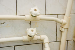 Old faucets in a bathroom Stock Image