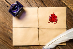 Old feather, envelope, sealing wax and ink bottle Stock Image