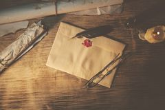 Old feather, envelope, sealing wax. On wooden table Royalty Free Stock Photo
