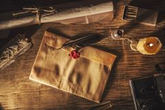 Old feather, envelope and  sealing wax. Old feather, envelopz and  sealing wax on wooden table Royalty Free Stock Image