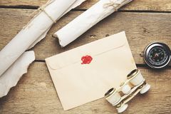 Old feather, envelope, telescope and compass royalty free stock photography