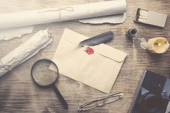 Old feather, envelope and  sealing wax. Old feather, envelopz and  sealing wax on wooden table Stock Photos