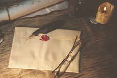 Old feather, envelope and  sealing wax. Old feather, envelopz and  sealing wax on wooden table Stock Images