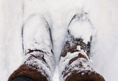 Old felt boots standing on a snow Stock Photo