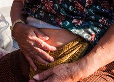 Old female Asian with her abdomen for inject insulin Royalty Free Stock Photo