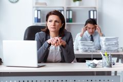 The old female boss and young male employee in the office stock images