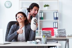 The old female boss and young male employee in the office stock photography