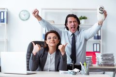 The old female boss and young male employee in the office royalty free stock image