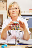 Old female doctor with many drugs royalty free stock images
