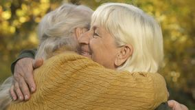 Old female friends hugging outside, sisters meeting, family connection, love. Stock footage stock footage