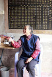 Old female guard of zhongde palace Royalty Free Stock Photography