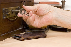 Old female hand with a key Stock Photo