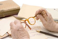 Old female hands hold glasses Royalty Free Stock Image
