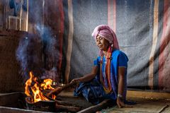 Old female karen hill tribe is cooking traditional. In the cottage of northern Thailand at Mae Klang Luang, Mae Chaem, Chiang Mai Province stock photography
