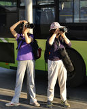 2 old female photographers  in street,shoot a film, take  picture,take photo, street view in China city Stock Photography