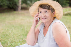Old female talking with friend Royalty Free Stock Image