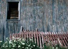 Old fence. An old fence rests alongside of an equally old barn Stock Photography