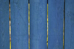 Old fence blue background for ads, wooden planks. Old fence blue background for ads, rough wooden planks Royalty Free Stock Image