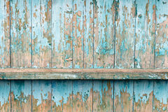 The old fence boards with chink. Painted light blue paint. From old age, almost all the coating peeled off Royalty Free Stock Photo