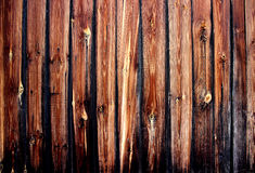 Old fence from boards. Old wooden fence, texture of old boards Royalty Free Stock Images