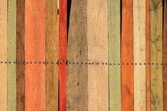 Old fence of colored wooden planks as background.  stock image