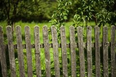 Old fence at country side. Haystack and racker Stock Photo