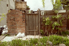 Old fence and doors. Royalty Free Stock Photo