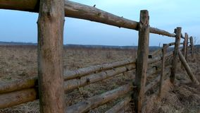 Old fence in the field in early spring stock footage