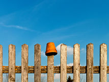 Old fence with flower pot Royalty Free Stock Image