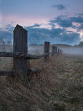 Old fence in the fog Stock Images