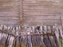 Old fence. In front of the remains of the old wooden wall. Could be used as background Stock Images