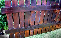 Old Fence made of Wooden Planks. Old Fence in the garden made of Wooden Planks stock photos