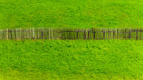 Old fence grass background Stock Images