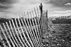 Old fence through mountains. Old broken fence running through the mountain countryside in Wyoming Royalty Free Stock Photos