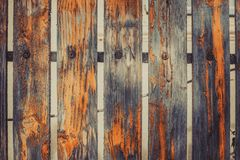 Old fence with the orange peeled-off paint royalty free stock photo