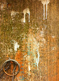 Old fence with paint stains with metal ring and chain. Royalty Free Stock Images