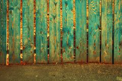 Old fence painted in teal color royalty free stock photos