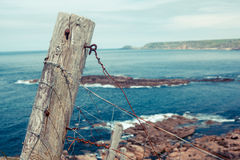 Old fence post by the sea Royalty Free Stock Image