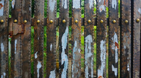 Old fence. And rusted plate Royalty Free Stock Images
