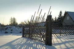 Old fence in snowy countryside royalty free stock images
