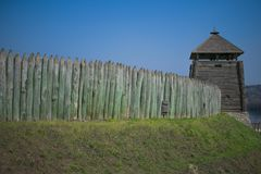 Old fence of a stockade and watchtower against a blue sky backgr. Ound Royalty Free Stock Photos