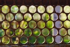 Old fence with the sun. Background Royalty Free Stock Photos