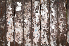 Old fence texture with scraps of paper ads Stock Images