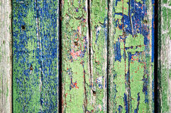 Old fence. Texture of old wooden fence painted in green and blue Stock Images