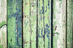 Old fence. Texture of old wooden fence painted in green and blue Royalty Free Stock Image