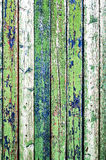 Old fence. Texture of old wooden fence painted in green and blue Royalty Free Stock Photo