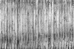 Old fence from wooden boards,wooden background, black and white texture. Old fence from wooden boards, black and white texture royalty free stock images