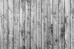 Old fence from wooden boards,wooden background, black and white texture. Old fence from wooden boards, black and white texture stock photos