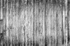 Old fence from wooden boards,wooden background, black and white texture. Old fence from wooden boards, black and white texture stock photography