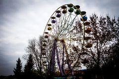 Old Ferris Wheel in dendro park, Kropyvnytskyi, Ukraine. An old rusty Ferris Wheel is one of the attractions in amusement park in Kropyvnytskyi Kirovograd Royalty Free Stock Photos